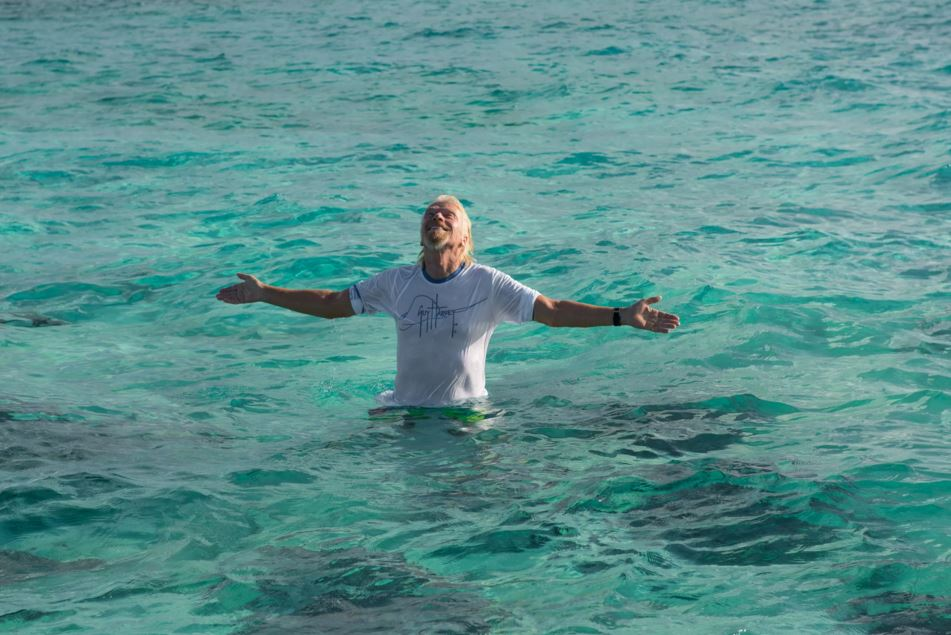 Richard Branson enjoying his time in the sea before he was savagely attacked by a gang of marauding stingrays (part of the shark family) (Picture: Virgin.com)