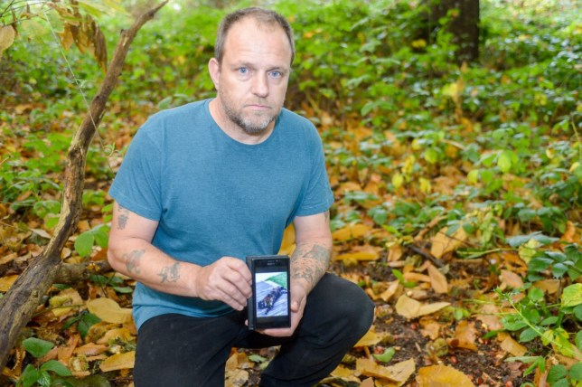 Wayne Bryant with a photograph of his cat Amber at the site where she was found in Croydon, south London (Picture: Tony Kershaw,SWNS.com)