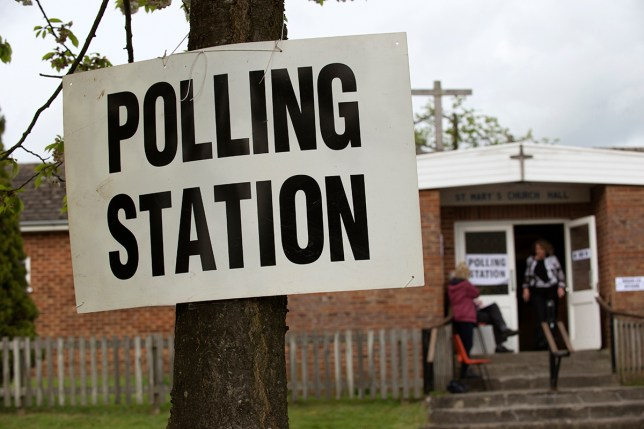 Polling station notice tied to a tree on election day in the UK. (Photo by: Education Images/UIG via Getty Images)