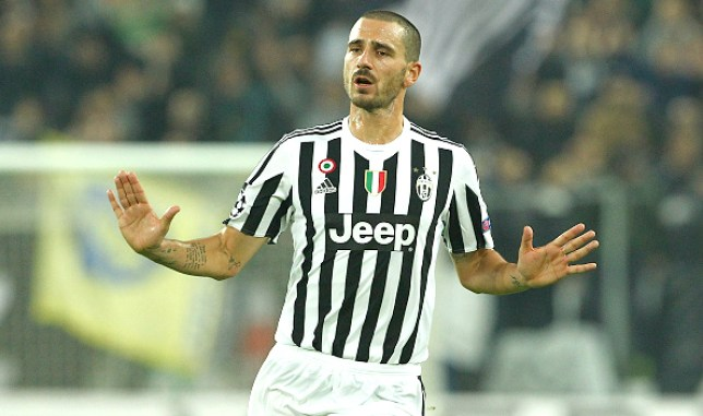 xxx of Juventus challenges xx of Moenchengladbach during the UEFA Champions League group stage match between Juventus and Borussia Moenchengladbach at Juventus Arena on October 21, 2015 in Turin, Italy.