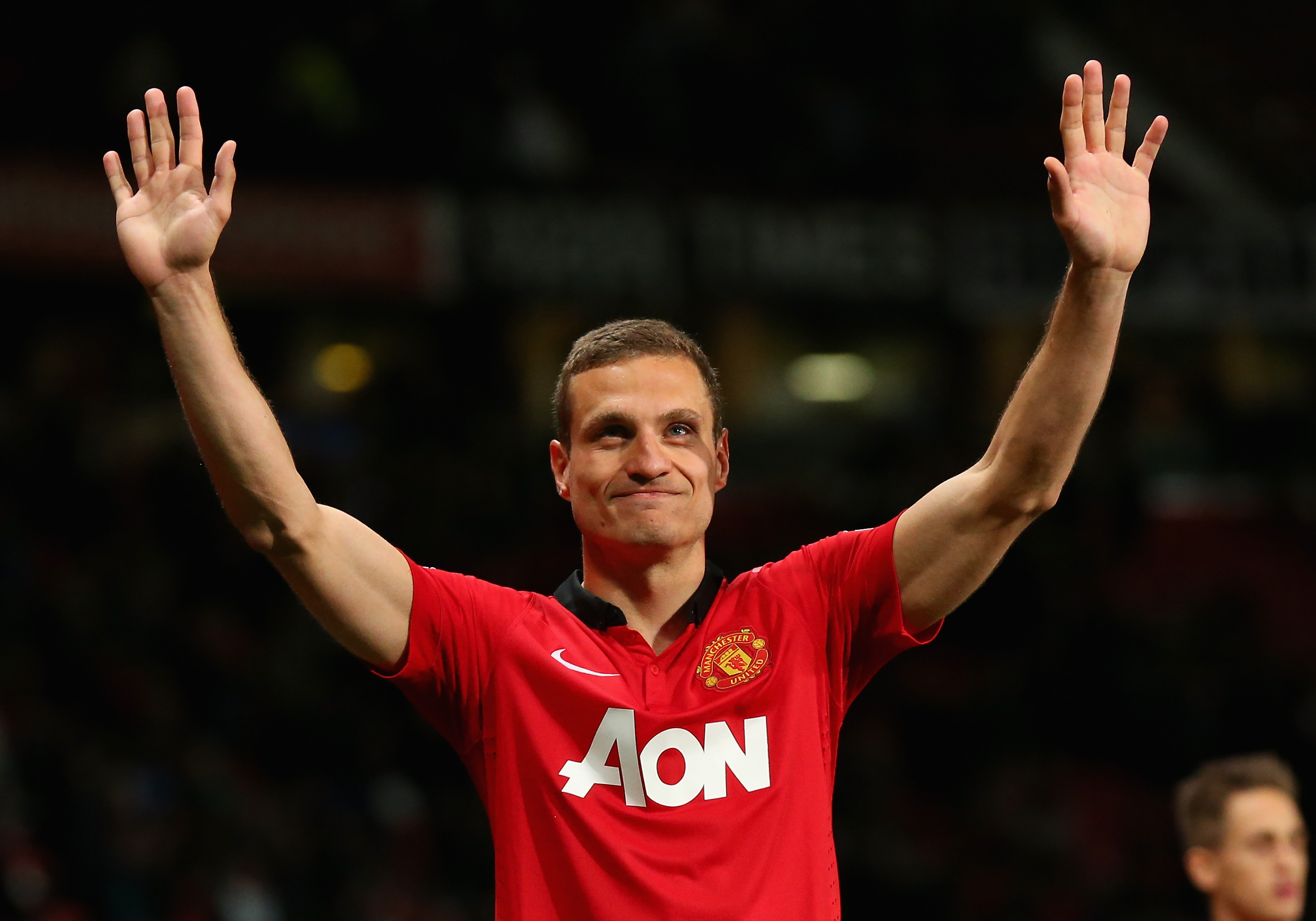 MANCHESTER, ENGLAND - MAY 06: Nemanja Vidic of Manchester United salutes the fans after his final home game for the club at the end of the Barclays Premier League match between Manchester United and Hull City at Old Trafford on May 6, 2014 in Manchester, England. (Photo by Alex Livesey/Getty Images)