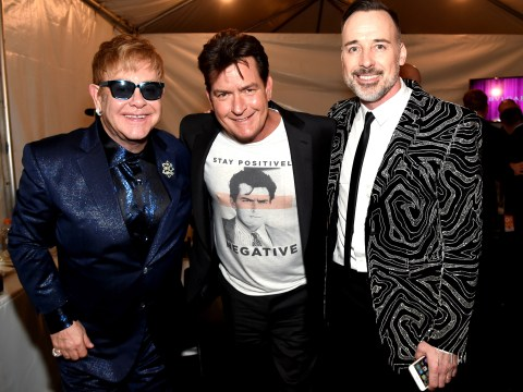 Charlie Sheen made a point of bringing his HIV status to Elton John's Oscars party