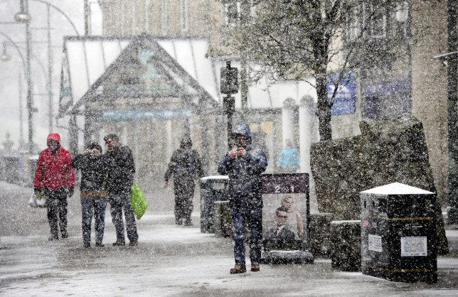 """People makes their way through Buxton town centre, Derbyshire, as forecasters said that Storm Jake may bring ice, snow and 70mph winds. PRESS ASSOCIATION Photo. Picture date: Wednesday March 2, 2016. The Met Office has issued yellow """"be aware"""" warnings for snow and ice for much of northern England and northern Wales, Scotland and Northern Ireland, with up to 5cm expected in many places, rising to 10cm on higher ground. See PA story WEATHER Snow. Photo credit should read: John Giles/PA Wire"""