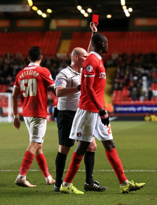Referee Charles Breakspear sends off Charlton Athletic's Yaya Sanogo towards the end of the match