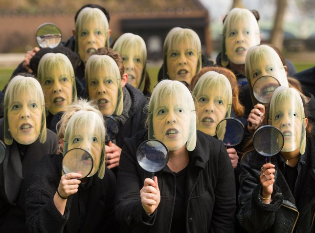 Members of the campaign group NoteMyVote.co.uk wearing masks of Home Secretary Theresa May at a photocall outside the Houses of Parliament, in Westminster, London, to protest against the speed with which the Investigatory Powers Bill is being pushed through the House of Commons. PRESS ASSOCIATION Photo. Picture date: Sunday March 13, 2016. Photo credit should read: Dominic Lipinski/PA Wire