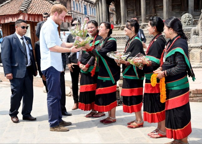 Mandatory Credit: Photo by Tim Rooke/REX/Shutterstock (5617136b) Prince Harry visits Kathmandu's historic Patan Durbar Square Prince Harry visit to Nepal - 20 Mar 2016 Prince Harry visits Kathmandu's historic Patan Durbar Square, a UNESCO World Heritage Site, which was damaged during the 2015 earthquake