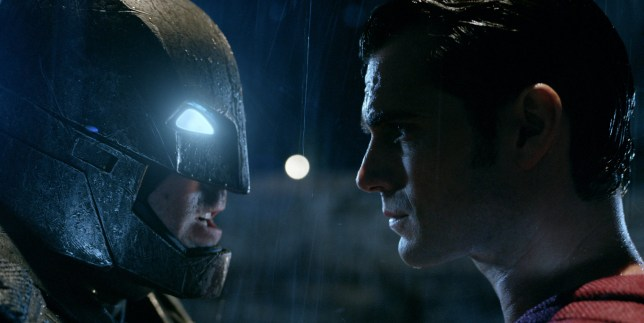 """This image released by Warner Bros. Pictures shows Ben Affleck, left, and Henry Cavill in a scene from, """"Batman v Superman: Dawn of Justice."""" (Warner Bros. Pictures via AP)"""