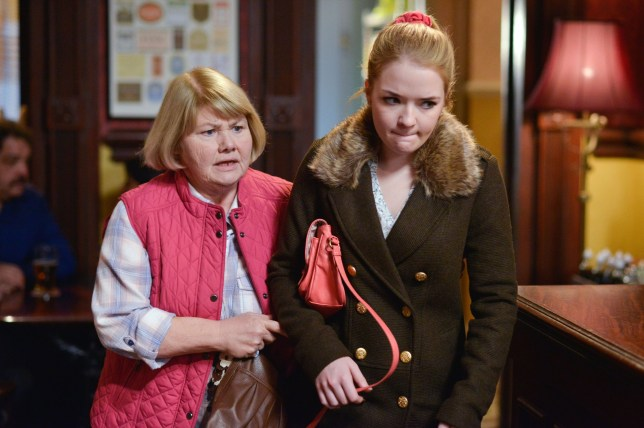 WARNING: Embargoed for publication until 00:00:01 on 22/03/2016 - Programme Name: Eastenders - TX: 28/03/2016 - Episode: 5253 (No. n/a) - Picture Shows: Babe quickly ushers Abi out of the pub. Aunt Babe (ANNETTE BADLAND), Abi Branning (LORNA FITZGERALD) - (C) BBC - Photographer: Kieron McCarron