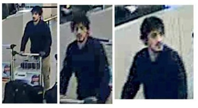 epa05226547 A handout image provided by Belgian Federal Police shows a CCTV grab of one of the three suspects in the Zaventem airport attack in Brussels, Belgium, 22 March 2016. A surveillance camera at Zaventem airport in Brussels captured footage of the alleged perpetrators of the explosions that took place earlier the day. It reveals two men dressed in black and both wearing one glove on their left hand, which according to La Libre Belgique could have served to conceal the detonators. The third (not pictured), dressed in a white jacket and wearing a black hat, is being 'actively pursued' in the meantime, according to Belgian newspapers. EPA/BELGIAN FEDERAL POLICE / HANDOUT BEST QUALITY AVAILABLE HANDOUT EDITORIAL USE ONLY/NO SALES