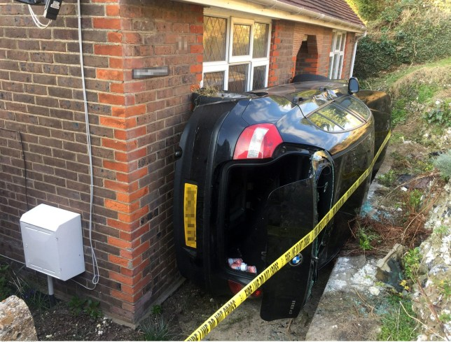 INS News Agency Ltd 23/03/2016 Oops! This has to be the best attempt at parking in a tight spot you have ever seen. Firefighters had to be called in after the driver of the black BMW lost control of her vehicle and mounted a grass bank alongside a house. The car then gracefully slid on its side before neatly dropping into the slot between the house and the bank. The woman motorist had to be pulled to safety by fire crews but was not seriously hurt. See copy INScar