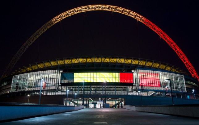 LONDON, ENGLAND - MARCH 23: The arches of Wembley Stadium are illuminated with the colours of the flag of Belgium on March 23, 2016 in London, England. Belgium is observing three days of national mourning after 31 people were killed in a twin suicide blast at Zaventem Airport and a further bomb attack at Maelbeek Metro Station. Two brothers are thought to have carried out the airport attack and an international manhunt is underway for a third suspect. The attacks come just days after a key suspect in the Paris attacks, Salah Abdeslam, was captured in Brussels. (Photo by Ben Pruchnie/Getty Images) *** BESTPIX ***