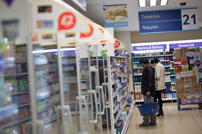 Tesco's new range of meat is from another made-up farm. Customers hold shopping baskets as they browse goods displayed for sale in the toiletries aisle inside a Tesco Metro store, operated by Tesco Plc, in London, U.K., on Wednesday, Oct. 16, 2013. Tesco Plc, the U.K.'s biggest grocer, reported unchanged U.K. same-store sales in its fiscal second quarter, excluding petrol and value-added taxes. Photographer: Simon Dawson/Bloomberg via Getty Images