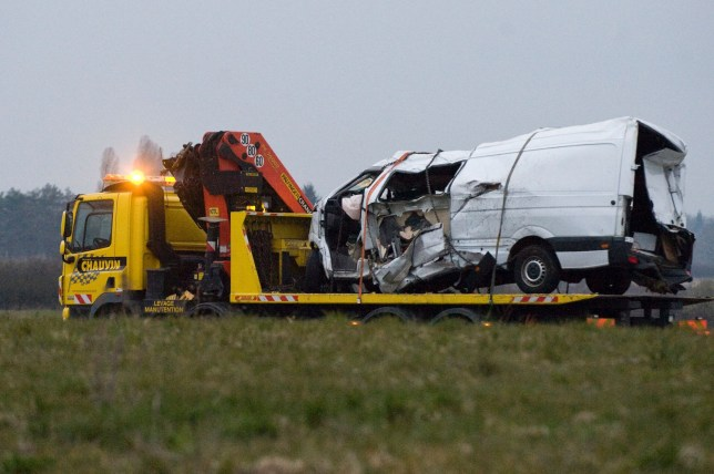 The wreckage of a minibus is being towed from an accident's site early on March 25, 2016 after it collided overnight with a truck in Montbeugny, central France. Twelve people were killed when the minibus they were travelling in collided with a heavy truck late March 24 in Allier, central France, local authorities said. / AFP PHOTO / Thierry ZoccolanTHIERRY ZOCCOLAN/AFP/Getty Images
