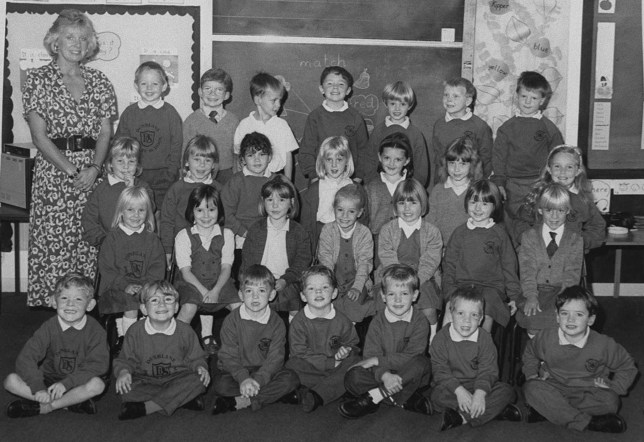 POY'96: DUNBLANE, SCENE OF CLASSROOM MASS KILLING, CLASS PHOTO...POY12:PICTURES OF THE YEAR:DUNBLANE,SCOTLAND,DEC96 - UNDATED FILE PHOTO - Teacher Gwen Mayor pictured with her class of 5 and 6 year old pupils from Dunblane Primary School. Sixteen pupils from the class were killed after gunman Thomas Hamilton opened fire in the gym at the school March 13. (BW ONLY) sec/HO REUTERS...I...DIS