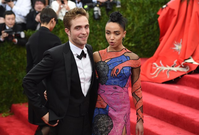 Robert Pattinson and FKA Twig arrives at the 2015 Metropolitan Museum of Art's Costume Institute Gala benefit in honor of the museums latest exhibit China: Through the Looking Glass May 4, 2015 in New York. AFP PHOTO / TIMOTHY A. CLARY (Photo credit should read TIMOTHY A. CLARY/AFP/Getty Images)
