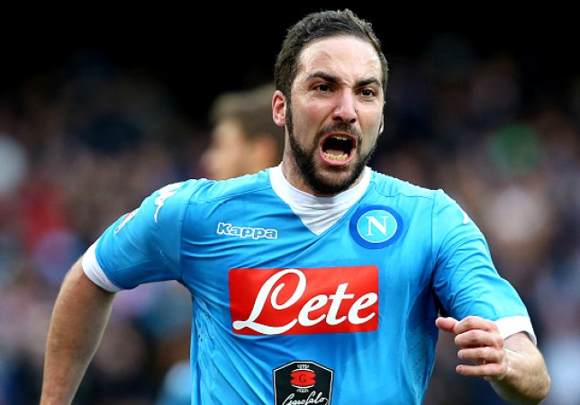 Allan of Napoli competes for the ball with Lorenzo Lollo of Carpi during the Serie A match between SSC Napoli and Carpi FC at Stadio San Paolo on February 7, 2016 in Naples, Italy.