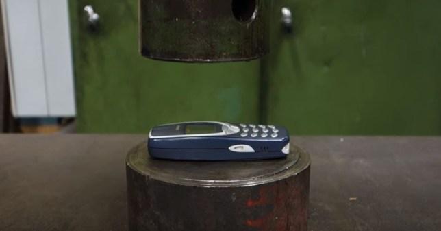 Hydraulic press vs classic Nokia 3310 (Picture: YouTube/Hydraulic Press Channel)