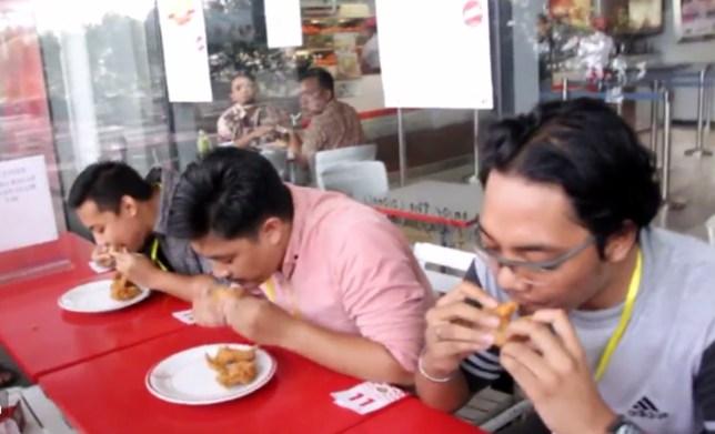 KFC eating contest - credit:Menang 5 Miliar/Twitter