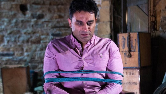 FROM ITV STRICT EMBARGO - No Use Before Sunday 1st May 2016 Emmerdale - Ep 7498 Tuesday 10 May 2016 In a barn, Cain Dingle [JEFF HORDLEY] has tied Rakesh Kotecha [PACHA BOCARIE] to a chair. Rakesh awakes and begins calling for help. Meanwhile, Cain ignores Priya's call on Rakesh's phone and he's obviously enjoying himself as he reassures Holly she's done the right thing telling him about Belle. However, Charity covers her alarm when she hears Belle's been out all night with her boyfriend, realising Cain's got the wrong guy. Picture contact: david.crook@itv.com on 0161 952 6214 Photographer - Andrew Boyce This photograph is (C) ITV Plc and can only be reproduced for editorial purposes directly in connection with the programme or event mentioned above, or ITV plc. Once made available by ITV plc Picture Desk, this photograph can be reproduced once only up until the transmission [TX] date and no reproduction fee will be charged. Any subsequent usage may incur a fee. This photograph must not be manipulated [excluding basic cropping] in a manner which alters the visual appearance of the person photographed deemed detrimental or inappropriate by ITV plc Picture Desk. This photograph must not be syndicated to any other company, publication or website, or permanently archived, without the express written permission of ITV Plc Picture Desk. Full Terms and conditions are available on the website www.itvpictur