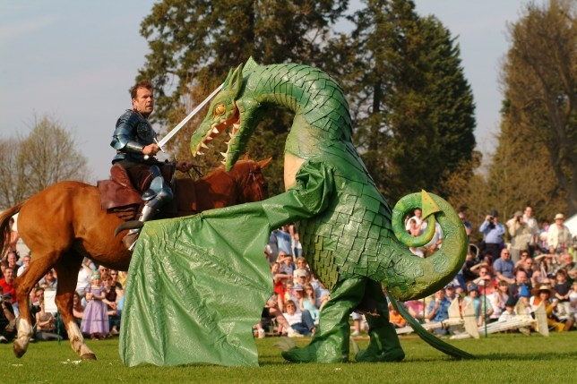 St George's Day at Wrest Park, Bedfordshire. A re-enactment celebrating the Patron Saint of England. St George comes face to face with the Dragon., Wrest Park Gardens, Bedfordshire, England. Additional Credit: English Heritage