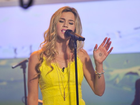 Joss Stone postpones world tour to be with her sick dog
