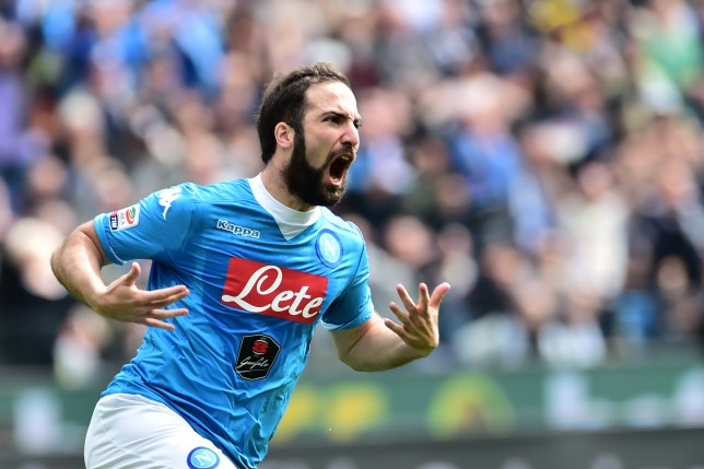 Napoli's forward from Argentina Gonzalo Higuain celebtrates after scoring during the Italian Serie A football match Udinese vs Napoli at Friuli Stadium in Udine on April 3, 2016. / AFP / GIUSEPPE CACACE (Photo credit should read GIUSEPPE CACACE/AFP/Getty Images)
