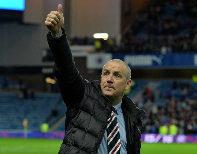 GLASGOW, SCOTLAND - APRIL 5 : Rangers manager Mark Warburton celebrates on the pitch as Rangers beat Dumbarton 1-0 to clinch the Scottish Championship title during the match between Glasgow Rangers FC and Dumbarton FC at Ibrox Stadium on April 5, 2016 in Glasgow, Scotland. (Photo by Mark Runnacles/Getty Images)