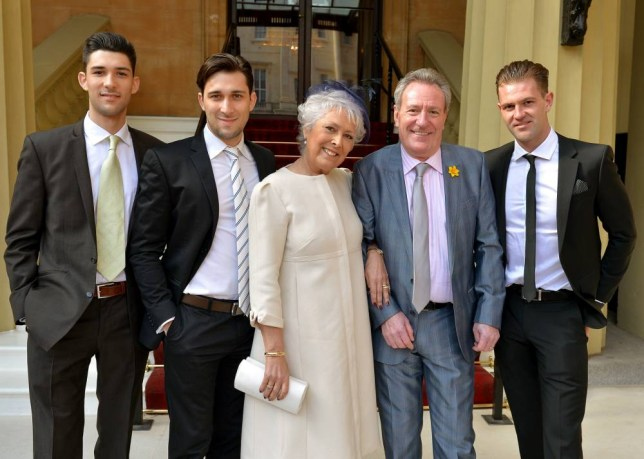 LONDON, UNITED KINGDOM - MARCH 14: Actress Lynda Bellingham with (left to right) sons Michael and Robert, husband Michael and step-son Bradley arrive at Buckingham Palace in central London for an Investiture Ceremony where she will receive an OBE (Officer of the Order of the British Empire) on March 14, 2014 in London, England. (Photo by John Stillwell - WPA Pool/Getty Images)