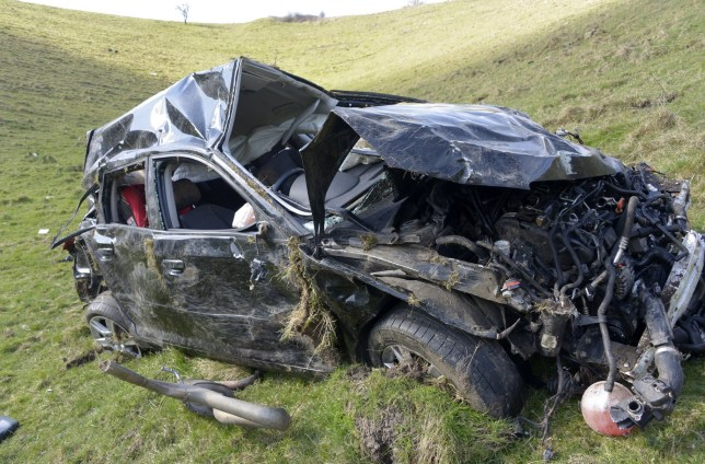 Pictured: The left the road at the top of Ditchling Beacon and ended up in the valley below. A woman miraculously escaped with cuts and bruises after her car plunged down a huge 490ft hill. The 28-year-old woman is lucky to be alive as she came off the road at the top of the hill and crashed down a steep incline of 150m to a valley below. Shocking pictures show how far the car black Audi A3 plummeted and also show how severely damaged it is following the dramatic crash. The entire 2009 vehicle was completely crumpled by the fall, all windows have smashed and a trail of loose car parts starts at the top of the hill and ends where it has landed. SEE OUR COPY FOR DETAILS. © Terry Applin/Brighton Argus/Solent News & Photo Agency UK +44 (0) 2380 458800