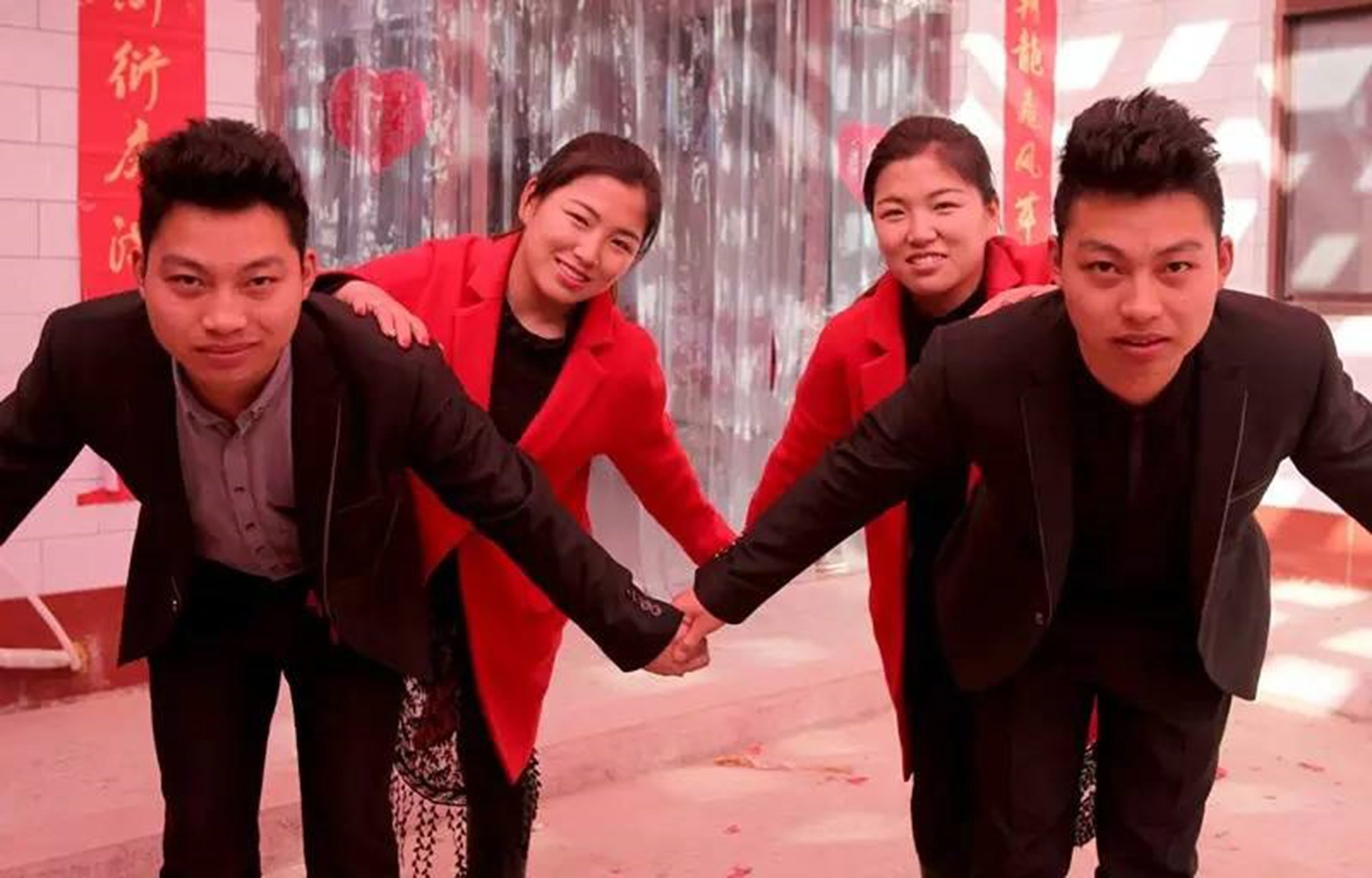 Pic shows: The two identical couples.nnA pair of identical twin brothers in China who married identical twin sisters are to have minor cosmetic surgery in order to help with their awkward identification problems.nnThe decision comes after friends and family had constantly complained about not being able to tell them apart before, during, and after their wedding.nnBut the issue reached a worrying point when one brother found himself holding the hand of his sister-in-law one night after dinner.nnZhao Xin and younger brother Zhao Xun, from a village in Yuncheng City, in North China¿s Shanxi Province, had been causing headaches for their relatives ever since they started dating sisters Yun Fei and Yun Yang, from a village 10 kilometres (6 miles) away.nnEven on their wedding day during the past Chinese New Year, the couples and their parents had to double-check several times to ensure they were not marrying the wrong partner.nnThe two pairs of identical siblings, aged 22, are said to be so alike that it is not even possible to tell them apart by their voices.nnWhile plastic surgery is still largely taboo in conservative Chinese societies, the couples and their relatives believe a minor adjustment would do them a world of good.nnThey are especially keen to avoid awkward situations similar to that which occurred earlier this year, when one newlywed husband apparently ended up holding the hand of his brother¿s wife during an evening stroll after dinner.nnReports said a hospital in China¿s eastern city of Shanghai has agreed to take on the couple¿s case, and will make small adjustments to their appearance so they can distinguish each other more easily.nn(ends)n