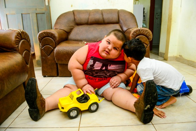 A FIVE-YEAR-OLD boy weighing more than 12 STONE is so large he risks being suffocated by his own bulk