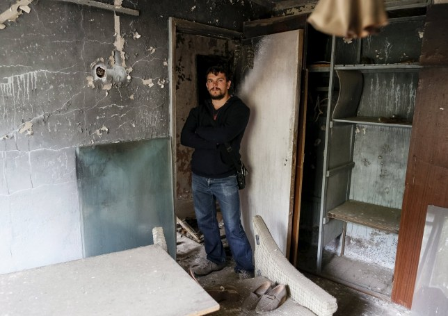"""Roman Chernyavskiy, 32, poses for a photograph in his flat which was evacuated after an explosion at the Chernobyl nuclear power plant, in the ghost town of Pripyat, Ukraine April 18, 2016. For residents of Chernobyl, a three-day evacuation turned into¬¿a thirty-year exile. Returning to their hometown of Pripyat on the eve of the anniversary, they recall their confusion and sacrifice in the wake of the world's worst nuclear accident. In the morning of April 26, 1986, one couldn't immediately tell that a meltdown in reactor 4 of the nuclear plant in then-Soviet Ukraine was poisoning the air with deadly radioactive particles. REUTERS/Gleb Garanich SEARCH """"RETURN PRIPYAT"""" FOR THIS STORY. SEARCH """"THE WIDER IMAGE"""" FOR ALL STORIES TPX IMAGES OF THE DAY TPX IMAGES OF THE DAY"""