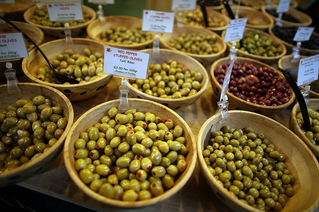 LONDON, ENGLAND - FEBRUARY 07: Olives are displayed for sale for sale at Borough Market on February 7, 2013 in London, England. Borough Market, London's oldest since 1756, has recently completed renovation and today had it's first day of full trading. (Photo by Peter Macdiarmid/Getty Images)