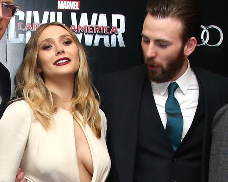 Actors Jeremy Renner, from left, Paul Bettany, Elizabeth Olsen, Chris Evans, Robert Downey Jr., Emily VanCamp and Daniel Bruhl pose for photographers upon arrival at the European Premiere of the film 'Captain America Civil War' in London, Tuesday, April 26, 2016. (Photo by Joel Ryan/Invision/AP)