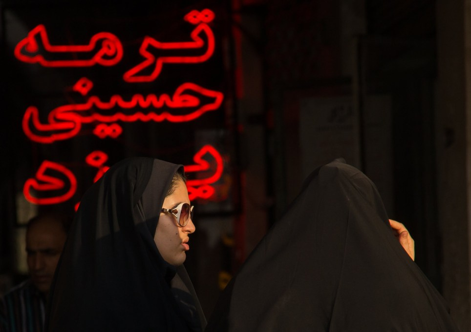 TEHRAN, IRAN - MAY/ OCTOBER 2015: The modern culture is modernising the traditional culture, taken in May/ October 2015, Tehran, Iran. SOCIAL media and smartphones are transforming Iranian women's culture and fashion. French photographer Eric Lafforgue, 52, travelled to the Islamic country to capture how the internet is helping to challenge the normally strict female dress code. Since the revolution in 1979 when Sharia law was imposed, women have been forced to cover their hair, neck and arms and to ìmaintain their modestyî. However, the introduction of iPhones and Instagram is influencing the younger generation to break the rules with branded chadors, make up and accessories. Photojournalist Eric, who visited the country twice in 2015, revealed the introduction of western cultural trends is posing a problem for the authorities. PHOTOGRAPH BY Eric Lafforgue/ Barcroft Images London-T:+44 207 033 1031 E:hello@barcroftmedia.com - New York-T:+1 212 796 2458 E:hello@barcroftusa.com - New Delhi-T:+91 11 4053 2429 E:hello@barcroftindia.com www.barcroftimages.com