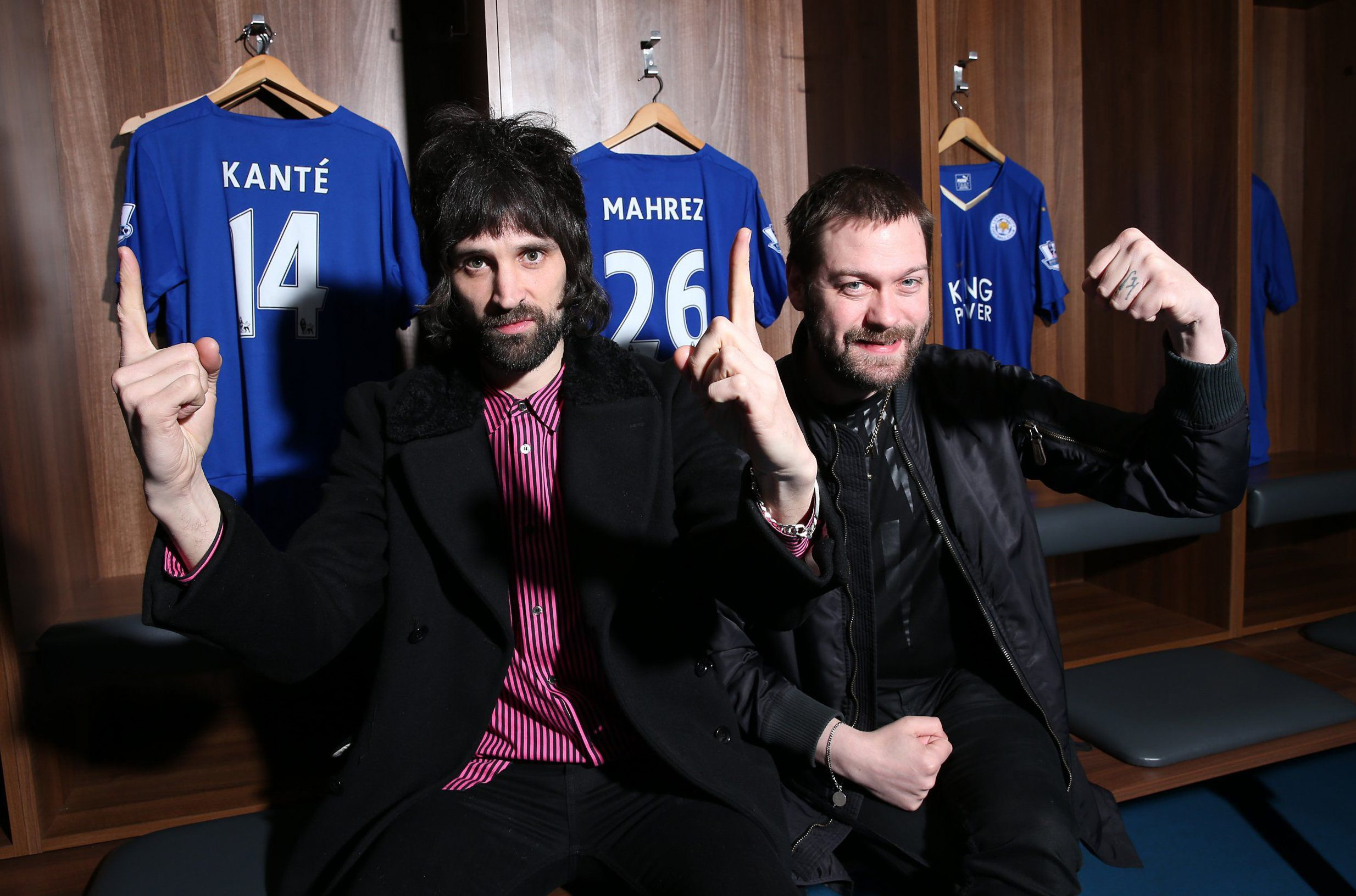 LEICESTER, ENGLAND - APRIL 28: Tom Meighan (R) and Serge Pizzorno (L) of Kasabian pictured as the band announce a summer concert at The King Power Stadium the home of Leicester City on April 28th, 2016 in Leicester, United Kingdom. (Photo by Plumb Images/Leicester City FC via Getty Images)