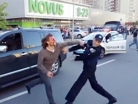 Ex-wrestler stopped for 'drink driving' – takes down SEVEN police officers trying to arrest him