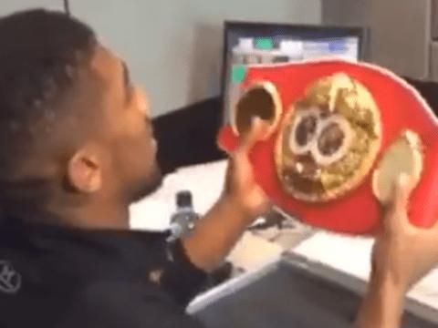 World champion boxer Anthony Joshua receives his IBF heavyweight belt