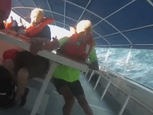 Woman films moment tourist boat tips over killing three people