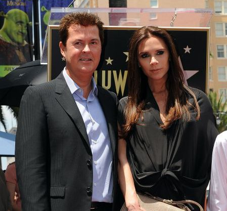 Producer Simon Fuller stands with Victoria Beckham and her son Brooklyn Beckham, after he unveilled his star at the ceremony honoring him with a Hollywood Walk of Fame star, held in Hollywood, California on May 23, 2011 AFP PHOTO/Mark RALSTON (Photo credit should read MARK RALSTON/AFP/Getty Images)