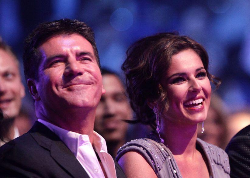 Reality television judge Simon Cowell wth singer Cheryl Fernandez-Versini. File photo dated 20/01/10 of Simon Cowell (left) and Cheryl Fernandez-Versini, as Cheryl reckons her X Factor boss Simon Cowell looks like a potato. PRESS ASSOCIATION