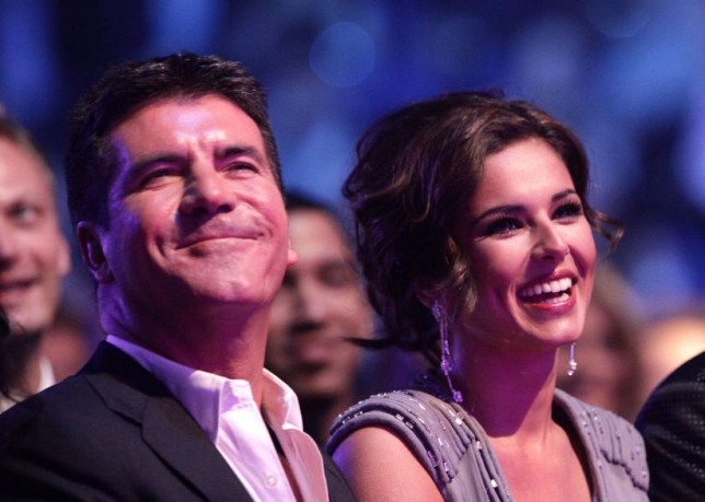 Reality television judge Simon Cowell wth singer Cheryl Fernandez-Versini. File photo dated 20/01/10 of Simon Cowell (left) and Cheryl Fernandez-Versini, as Cheryl reckons her X Factor boss Simon Cowell looks like a potato. PRESS ASSOCIATION