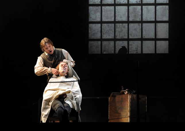 """Rod Gilfry (L) and John Graham-Hall perform respectively as Sweeney Todd and Beadle Bamford on April 19, 2011 at the Chatelet Theatre in Paris, during the dress rehearsal of Broadway musical show """"Sweeney Todd"""" by US composer and lyricist Stephen Sondheim. Staged for the first time in Paris, this musical directed by Lee Blakeley, will run from April 22 to May 21, 2011. AFP PHOTO MEHDI FEDOUACH (Photo credit should read MEHDI FEDOUACH/AFP/Getty Images)"""