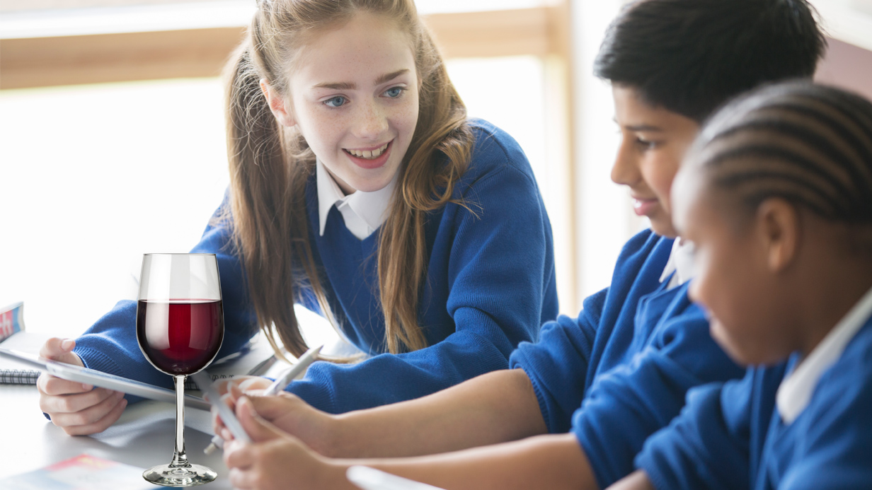 Pupils using tablet pcs in classroom