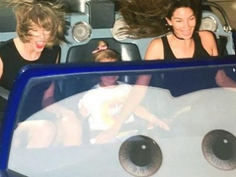Taylor Swift has a blast on a rollercoaster – but her bodyguard doesn't see the fun side
