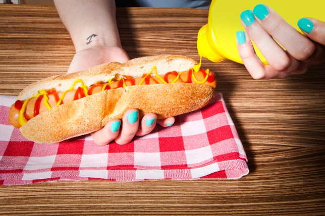 GIRLS HANDS WITH HOT DOG
