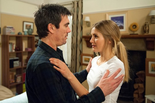 FROM ITV STRICT EMBARGO - No Use Before Tuesday 17 May 2016 Emmerdale - Ep 7512 Wednesday 25 May 2016 After Cain Dingle [JEFF HORDLEY] defends Holly Barton [SOPHIE POWLES] from a furious Charity Dingle [EMMA ATKINS], Holly leans in for a kiss. Will Cain fall for Holly's charms or will Holly be left devastated by his harsh rejection? Picture contact: david.crook@itv.com on 0161 952 6214 Photographer - Andrew Boyce This photograph is (C) ITV Plc and can only be reproduced for editorial purposes directly in connection with the programme or event mentioned above, or ITV plc. Once made available by ITV plc Picture Desk, this photograph can be reproduced once only up until the transmission [TX] date and no reproduction fee will be charged. Any subsequent usage may incur a fee. This photograph must not be manipulated [excluding basic cropping] in a manner which alters the visual appearance of the person photographed deemed detrimental or inappropriate by ITV plc Picture Desk. This photograph must not be syndicated to any other company, publication or website, or permanently archived, without the express written permission of ITV Plc Picture Desk. Full Terms and conditions are available on the website www.itvpictures.com