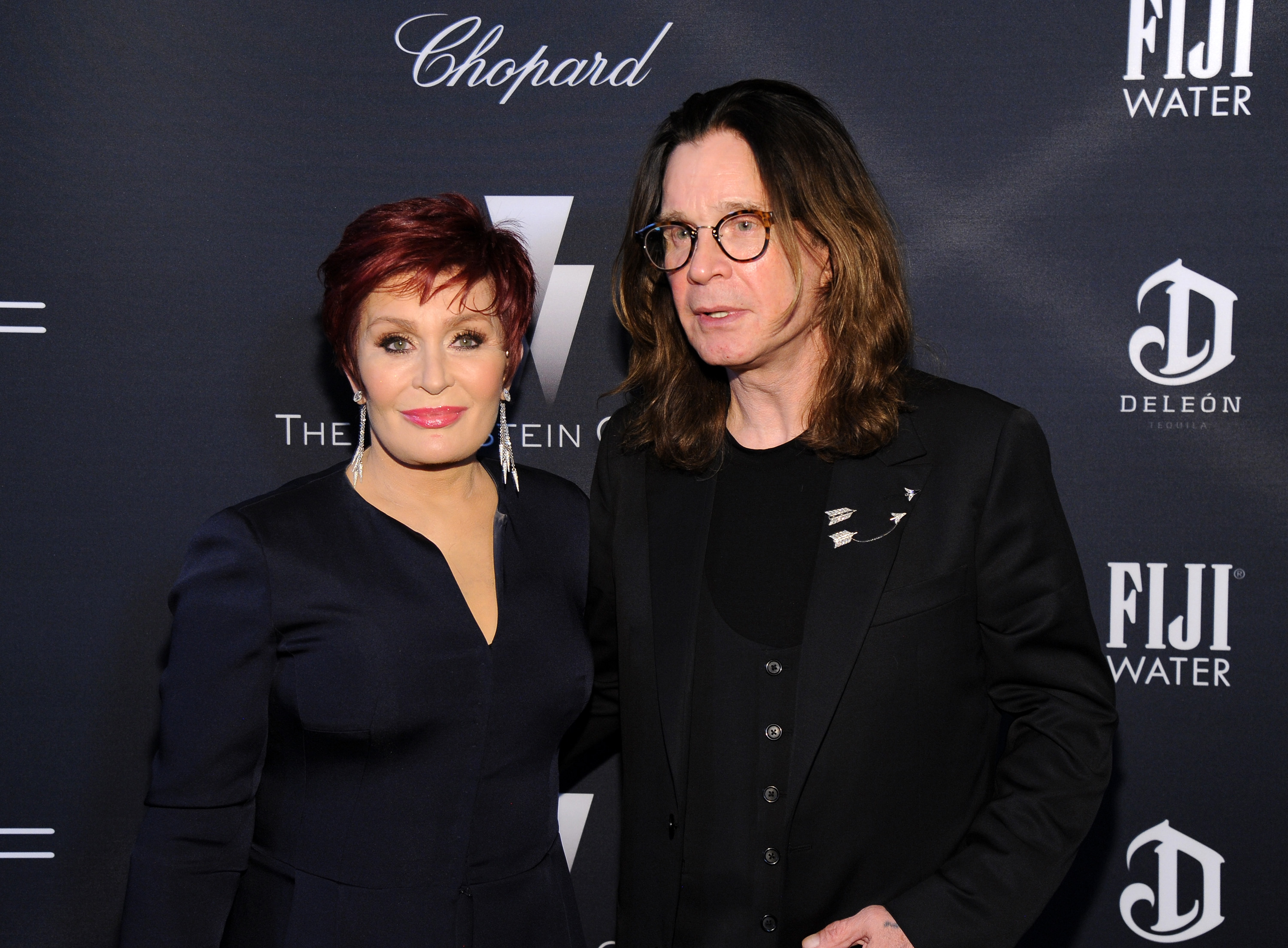 LOS ANGELES, CA - FEBRUARY 21: TV personality Sharon Osbourne and recording artist Ozzy Osbourne attend The Weinstein Company's Academy Awards Nominees Dinner in partnership with Chopard, DeLeon Tequila, FIJI Water and MAC Cosmetics on February 21, 2015 in Los Angeles, California. (Photo by Angela Weiss/Getty Images for FIJI Water)