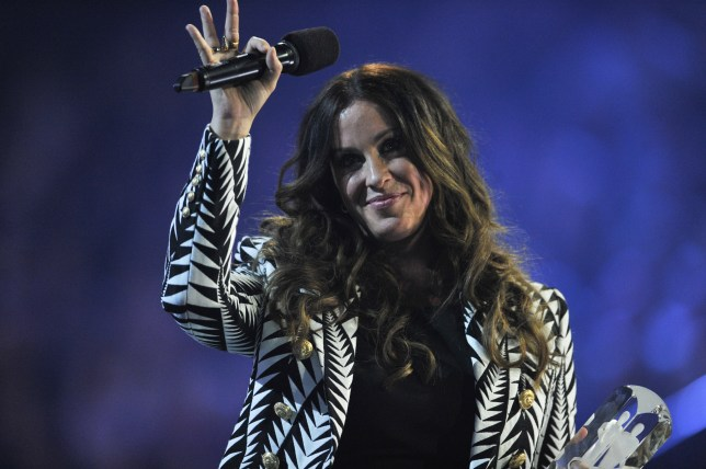 HAMILTON, ON - MARCH 15: Alanis Morissette is presented an award at the 2015 JUNO Awards at FirstOntario Centre on March 15, 2015 in Hamilton, Canada. (Photo by Sonia Recchia/Getty Images)