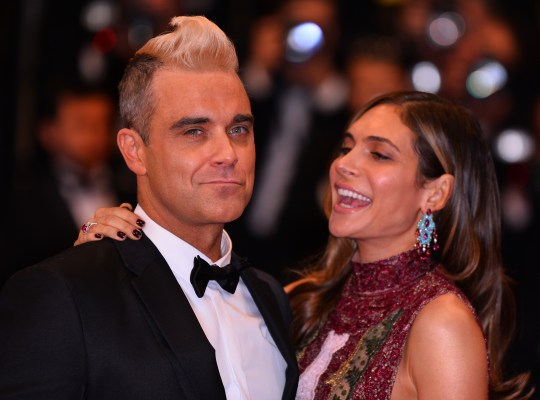 How old is Robbie Williams and what is his and Ayda Field's net